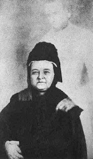A photograph of Mary Todd Lincoln thought to have the ghostly image of her dead husband, Abraham Lincoln standing in the background with his hands on her shoulders.