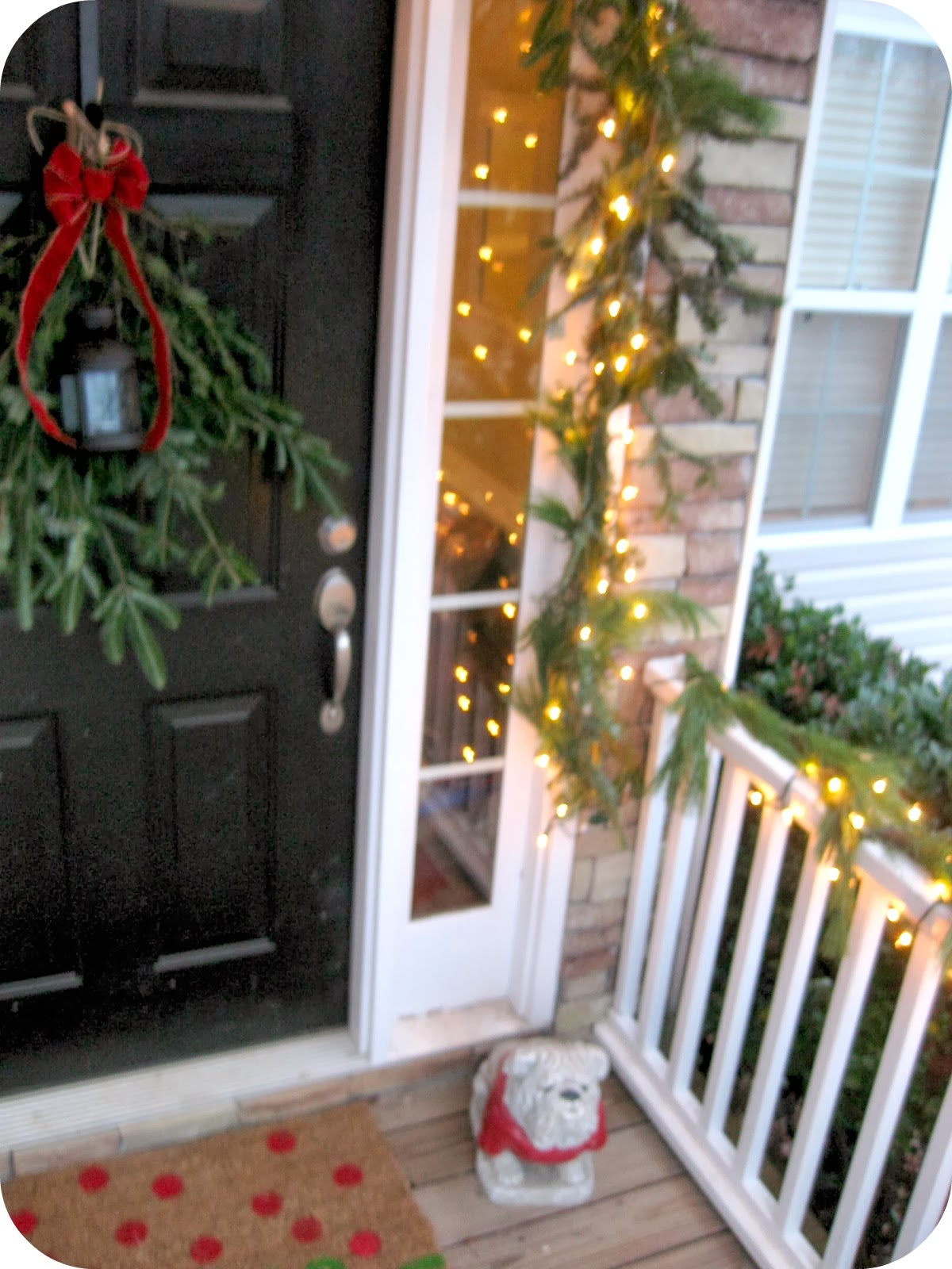 the rest of that roll plus about 8 of the second roll to affix to my railings with twine i strung some lights around the railings and the corner bush - Christmas Swag Lights