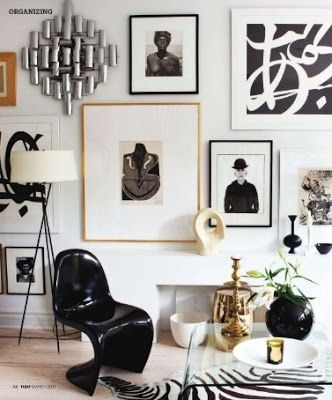 black panton chair with gallery wall