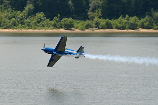 picture of Sky Combat Ace plane at the Evansville Freedom Festival flying just above the water