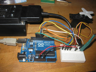 Arduino connected to servo and foot pedal radio dongle
