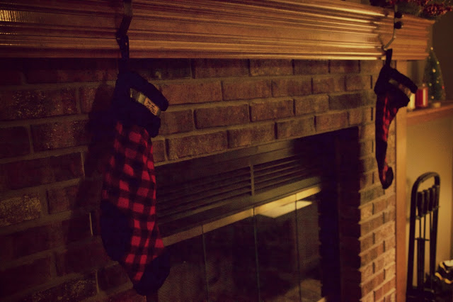 flannel stockings on the fireplace
