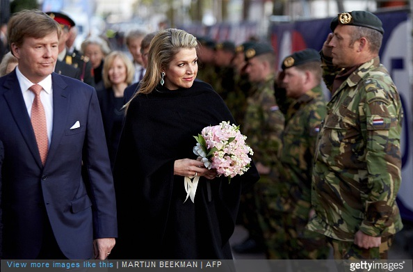 Dutch King Willem Alexander and Queen Maxima arrive at the Dutch 5th of May Liberation concert in Amsterdam on May 5, 2015