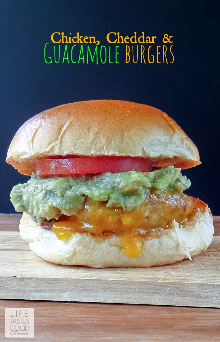 Chicken Cheddar and Guacamole Burgers | by Life Tastes Good are smothered in cheddar cheese and topped with a generous helping of guacamole for maximum delicious! #ChickenBurgers #Sandwich