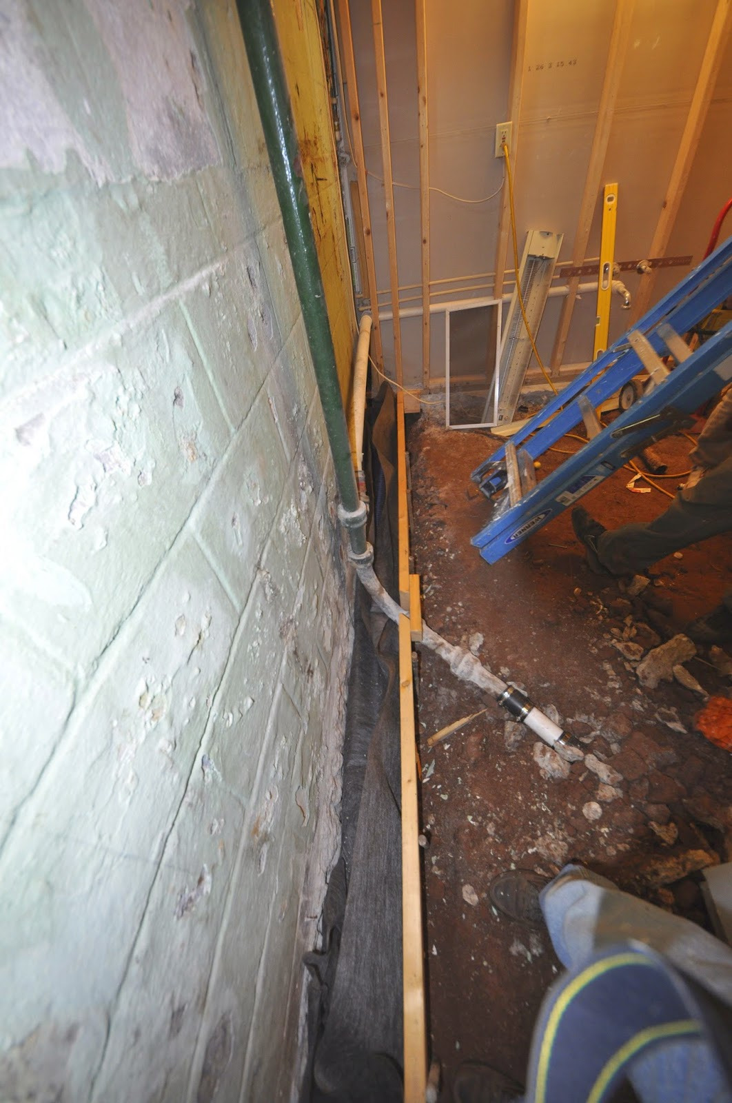 on this job a leaky basement bathroom was gutted waterproofed from