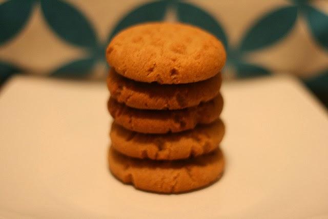 Five little peanut butter cookies waiting to be eaten.