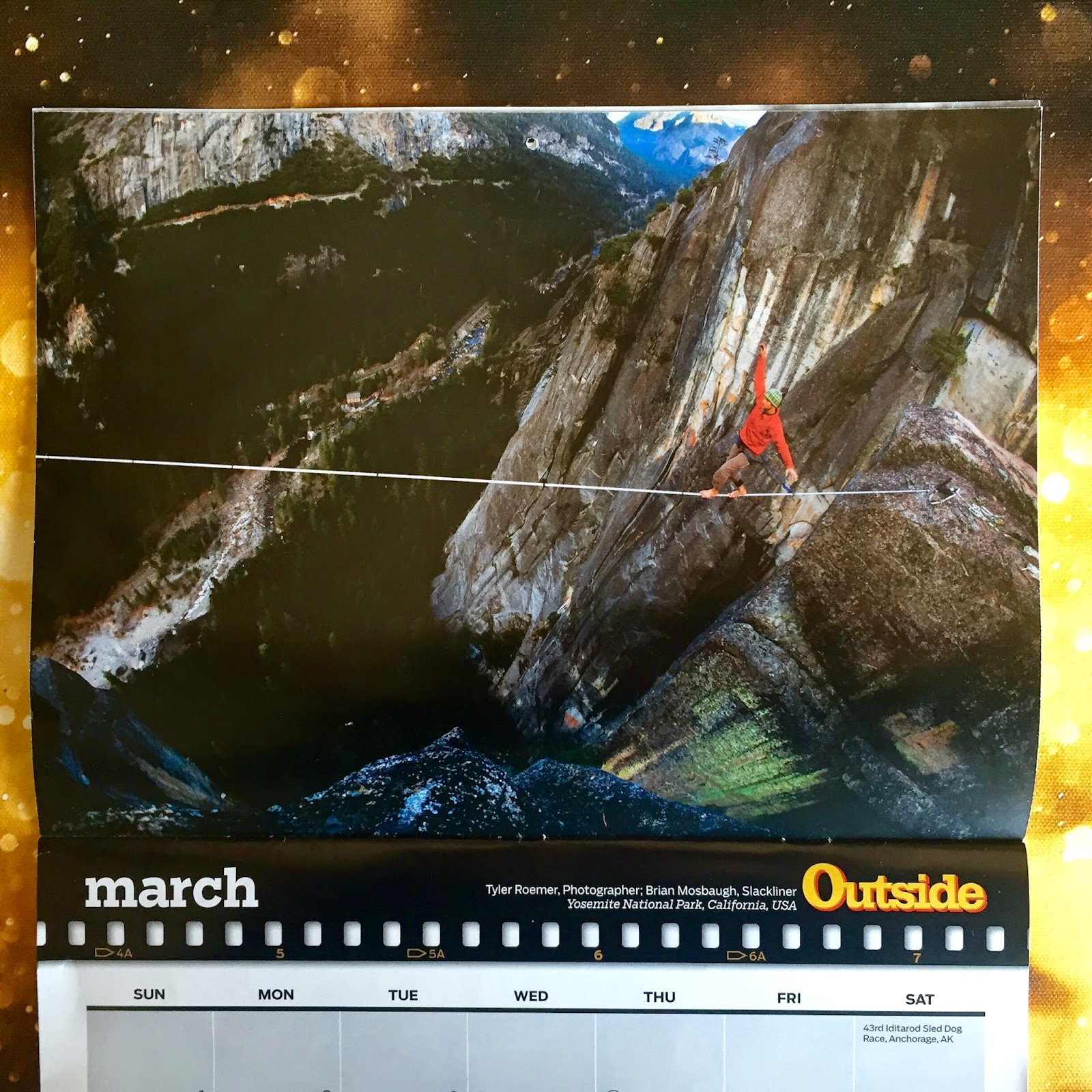 Outside Magazine Calendar of a highliner in Yosemite National Park in California.
