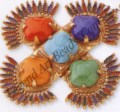 """This ethnic-style Castle cliff necklace draws inspiration from both Inca and Aztec themes. Large """"stones"""" made from plastic imitate the rough semi-precious stones loved by the early civilizations of South America. Bright enamelling is reminiscent of the feathers of exotic birds."""
