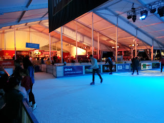 skating rink with view of bar