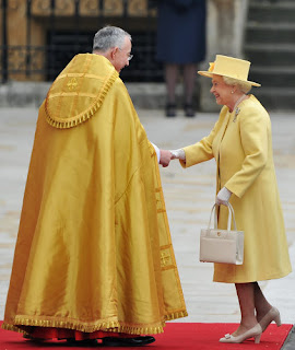 Queen Elizabeth II is greeted by The Right Reverend Dr John Hall, Dean of Westminster as she arrives.