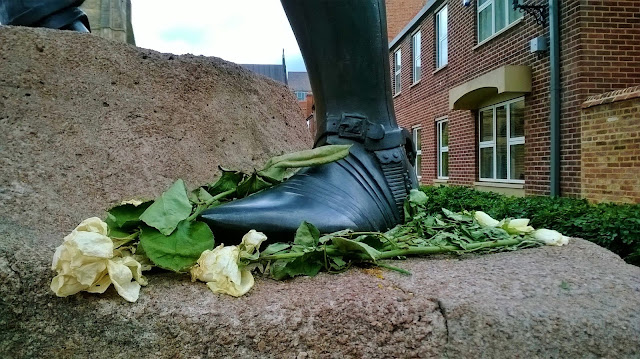 White roses at the foot of the statue of King Richard III in Leicester - photo by Katie @ Second-Hand Hedgehog travel blog