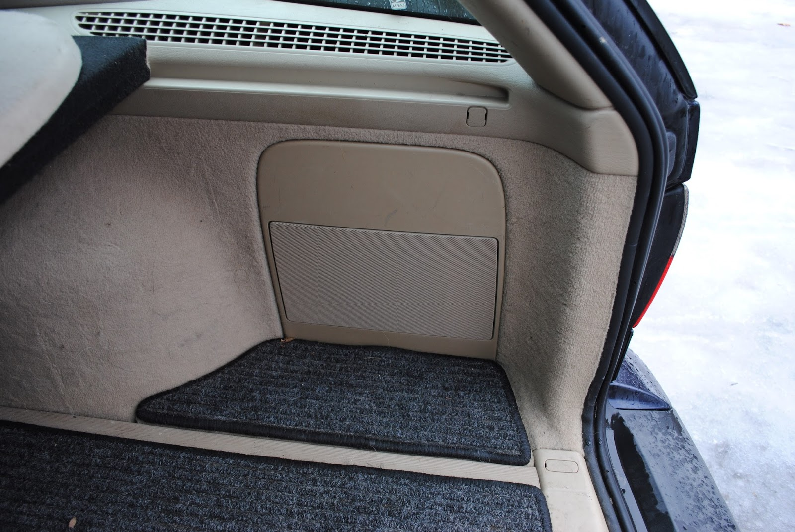 On 9-5 wagons, the subwoofer is located on the right-hand side of the  hatch, where a storage area would be on wagons not equipped with the eight  speaker ...
