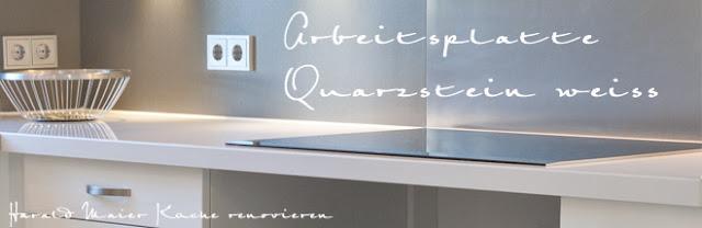 weisse Küche und weisse Arbeitsplatten aus Quarzstein