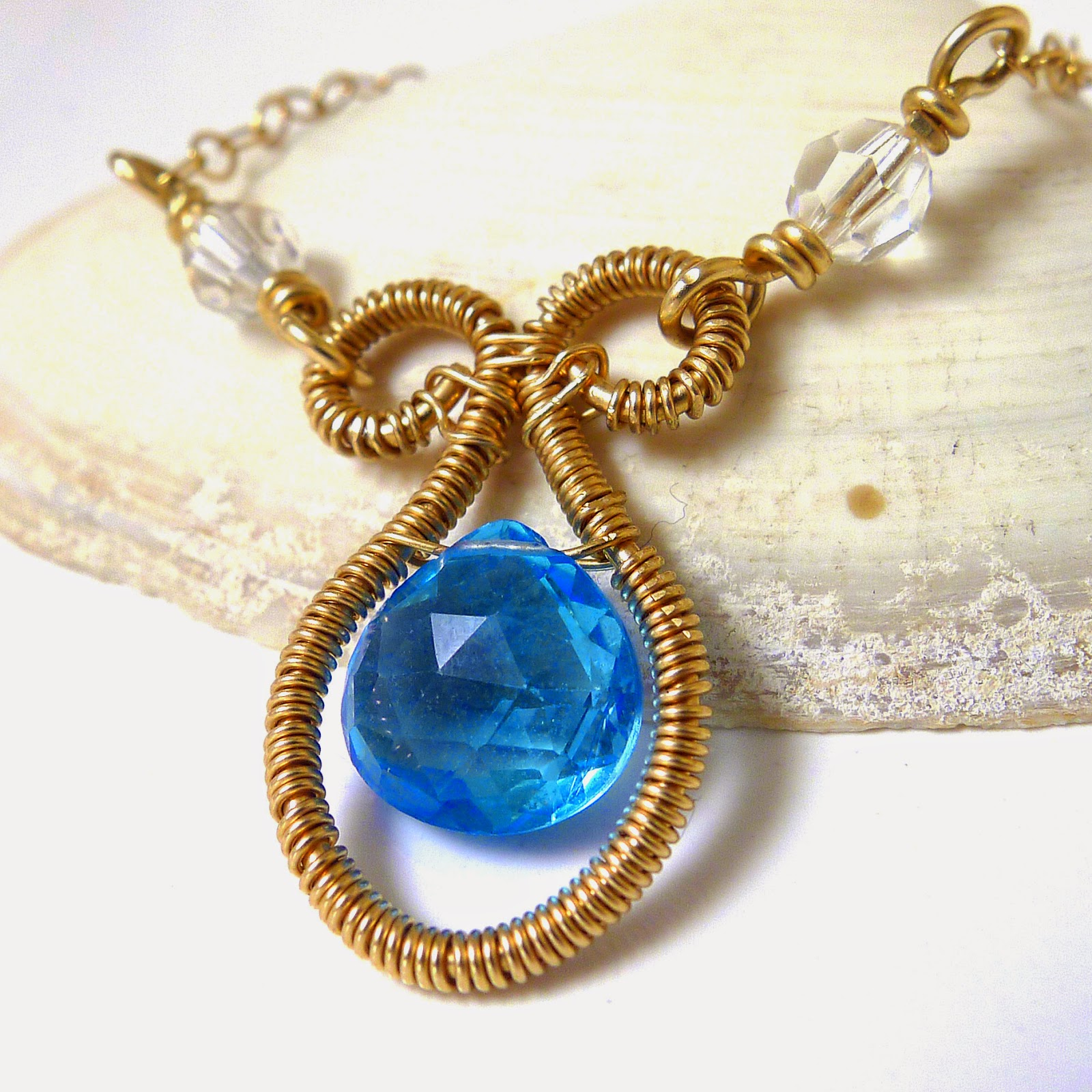 http://www.shazzabethcreations.co.nz/#!product/prd1/2522075541/swiss-blue-topaz-and-crystal-gold-necklace
