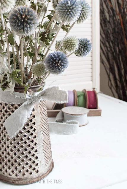 Make an antique grater flower vase instantly! By Keeping With The Times, featured on http://www.ilovethatjunk.com
