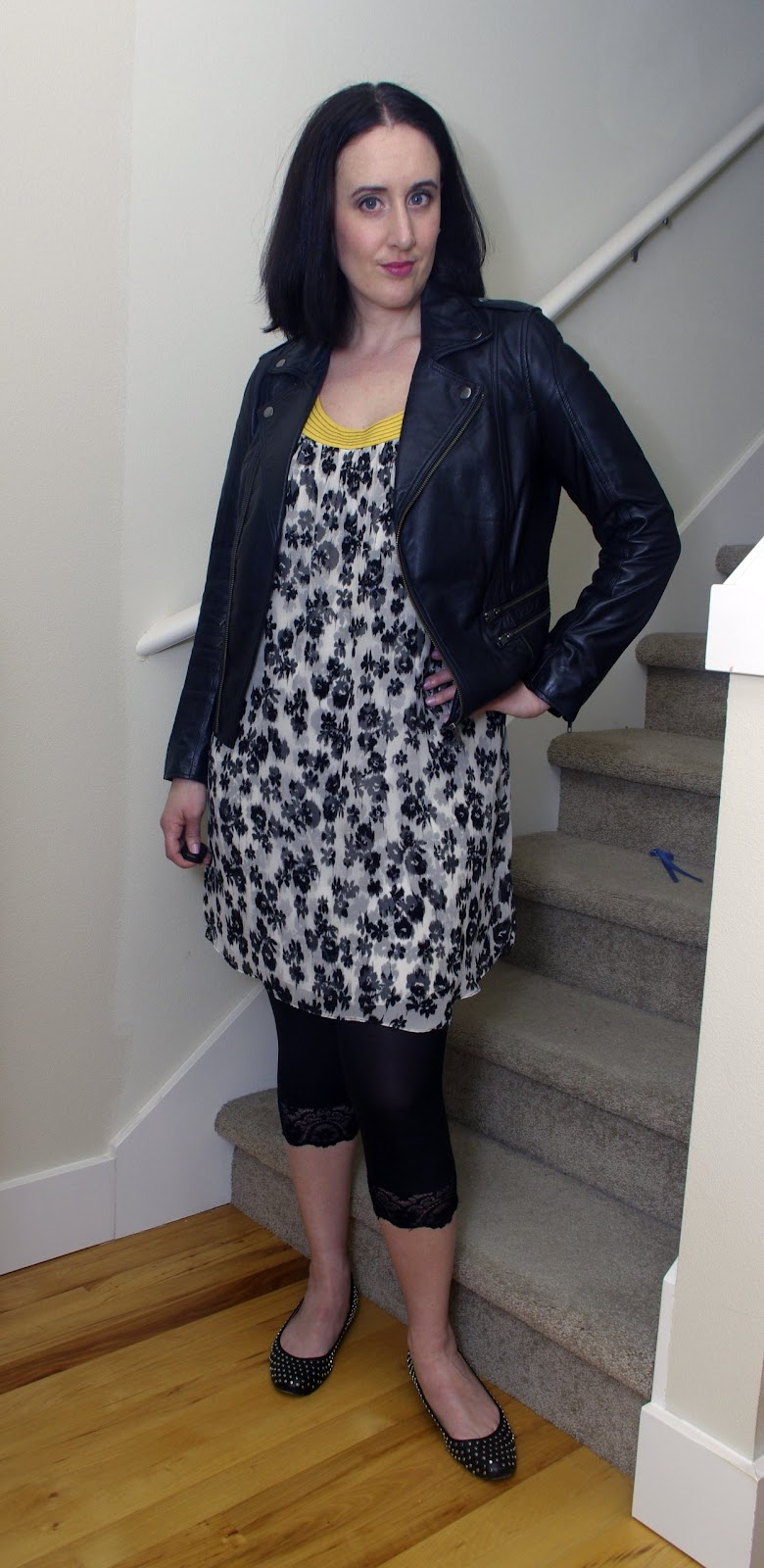 black and white floral shift dress, black moto jacket, black lace leggings, studded ballet flats
