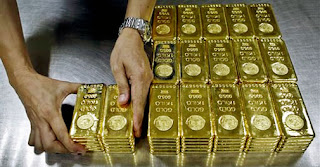 Gold prices rise in futures trade on firm global cues