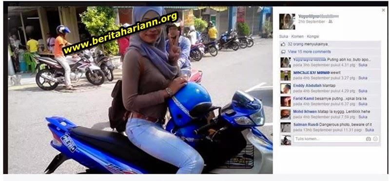 http://www.beritahariann.org/2014/12/gambar-ada-sesuatu-pada-dada-wanita-ini.html