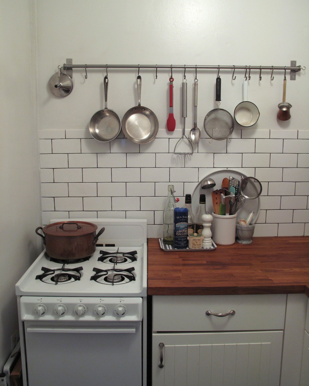 Simple Sunday June With Kitchen Utensil Rails.