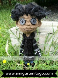 brown crochet doll with black jacket