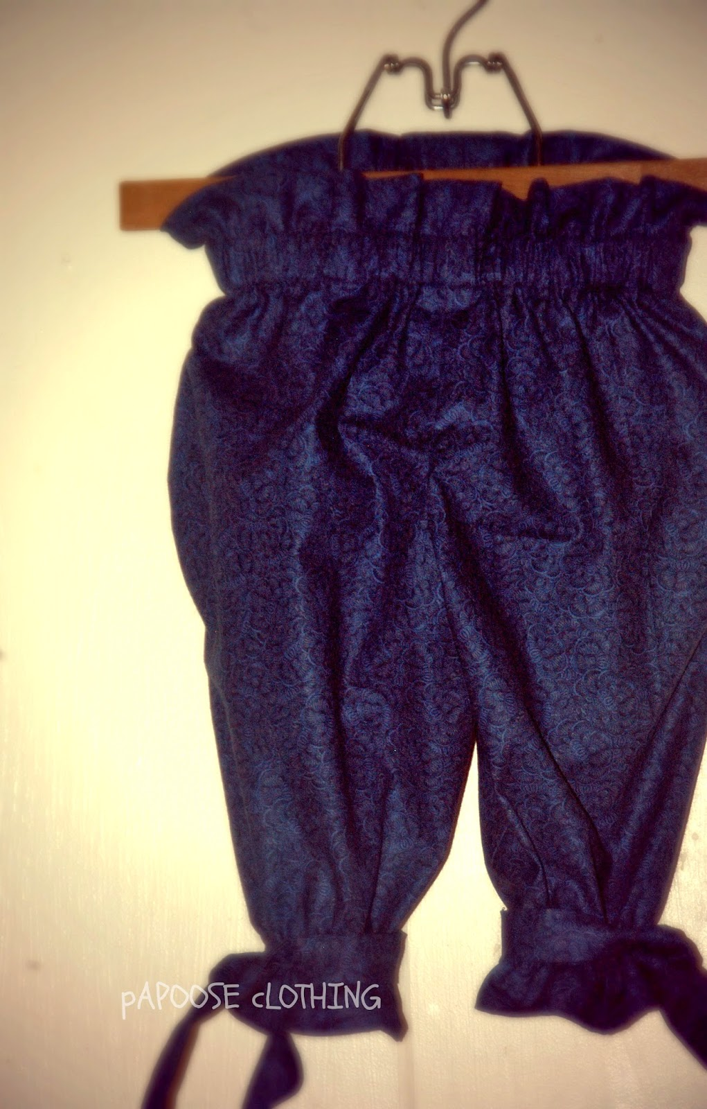 http://www.papooseclothing.com/store/p30/Singin%27_the_Blues_Ruffle_Top_Gathered_Capri_Pants.html
