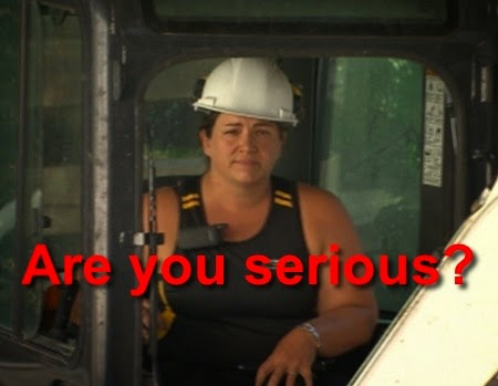 "Imaged of a female construction working giving a skeptical look to the camera with the caption ""are you serious?"""