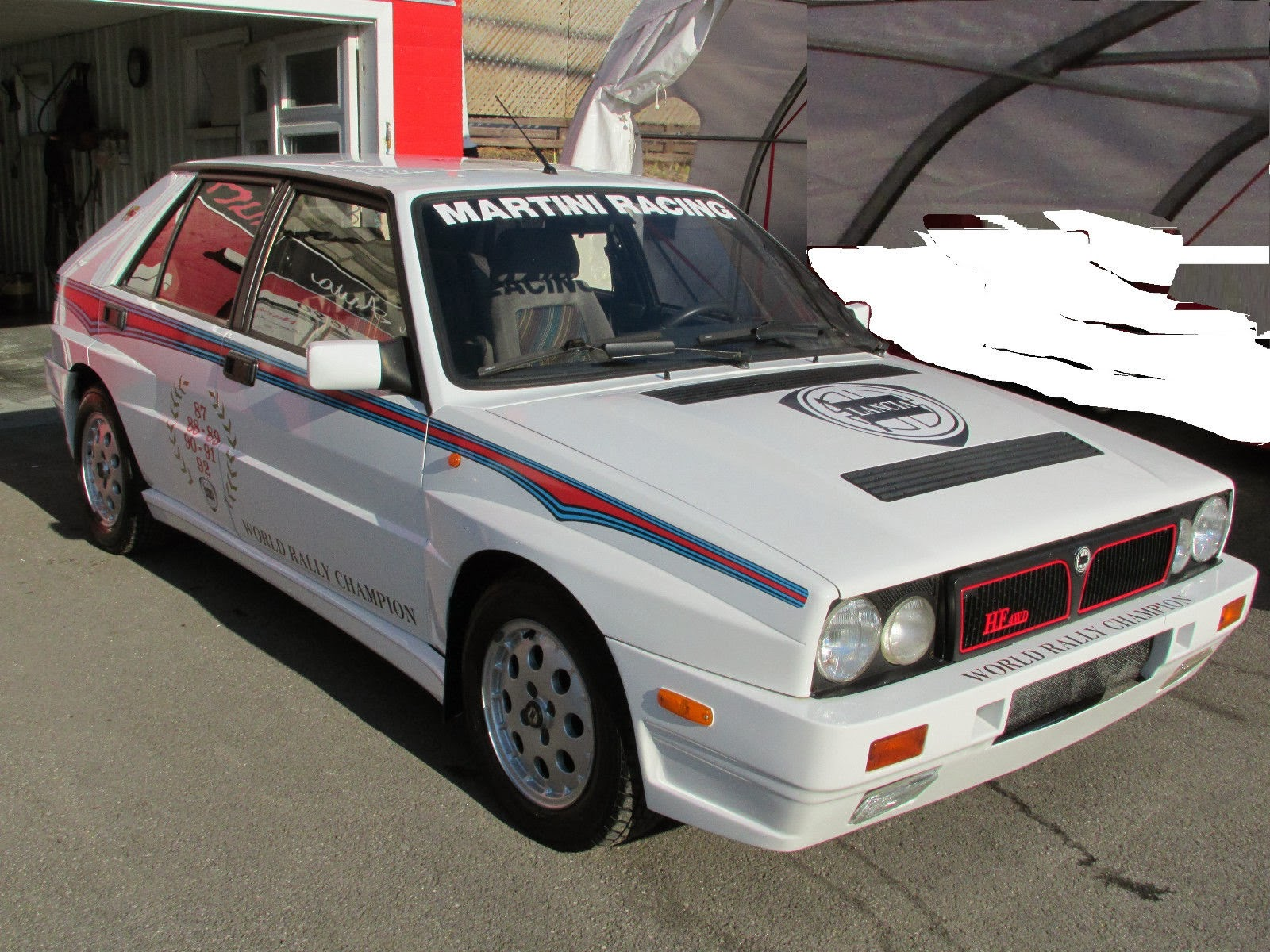 this delta started out as a simpleplain hf awd but someone has added integrale fender flares and a sweet martini racing paint scheme