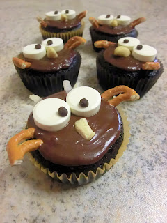 Halloween themed Hoot owl pumpkin chocolate muffins or frosted cupcakes