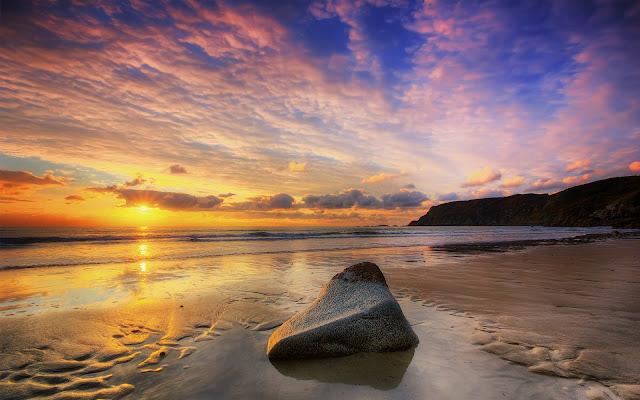Imagen de la Vista de una Atardecer desde la Orilla de la Playa imagenes de playas
