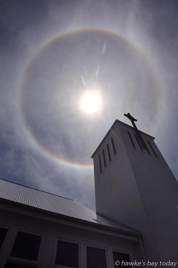 A sun halo above St Paul's Presbyterian Church, cnr Dalton St and Tennyson St, Napier. Wikipedia says the ice crystals responsible for halos are typically suspended in cirrus or cirrostratus clouds 5-10 km high in the upper troposphere. photograph
