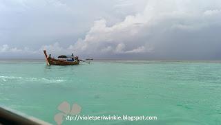 emerald sea blue sky boat