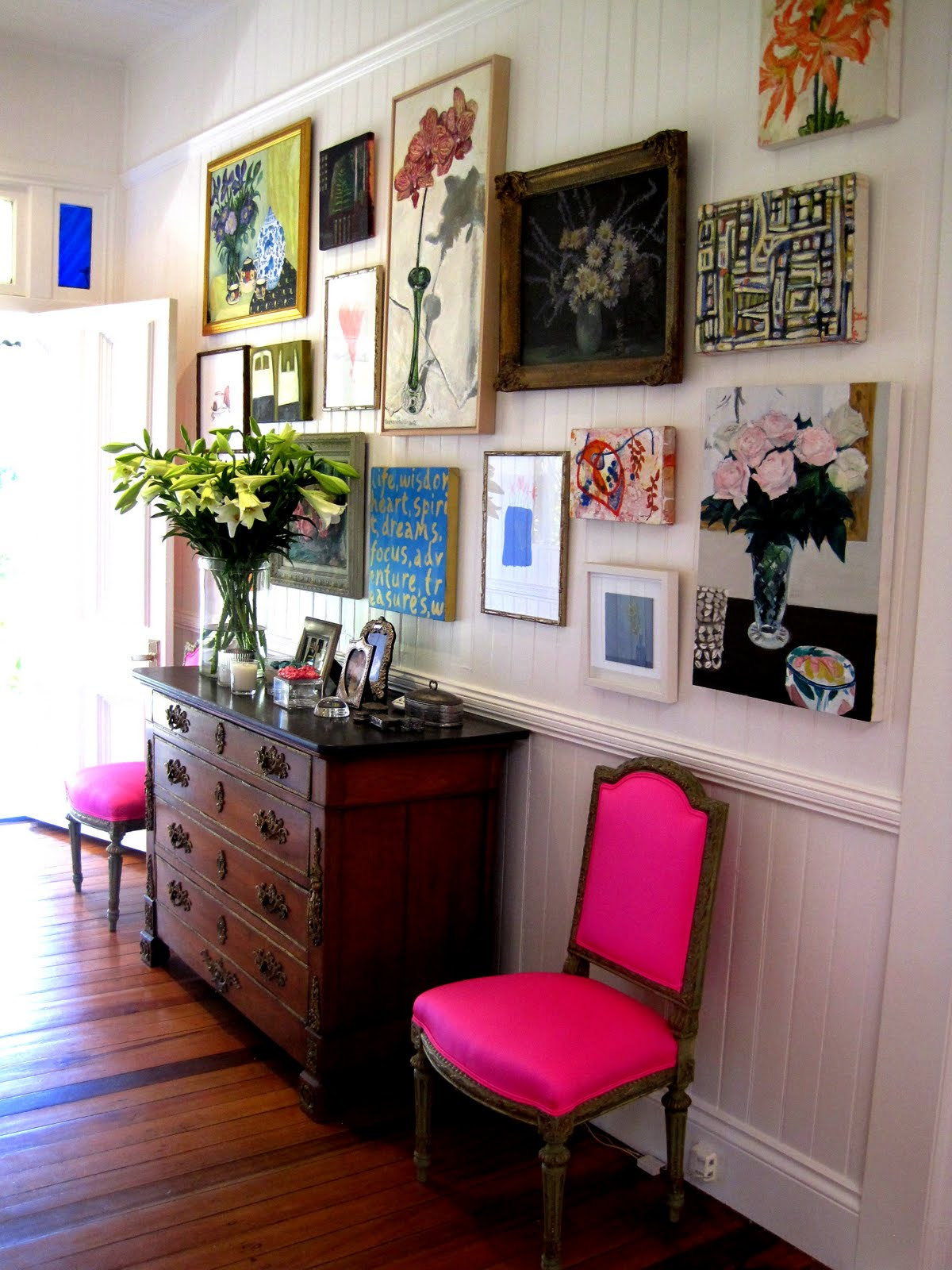 Dishfunctional designs create an eclectic gallery wall for Arrangement of photo frames on wall