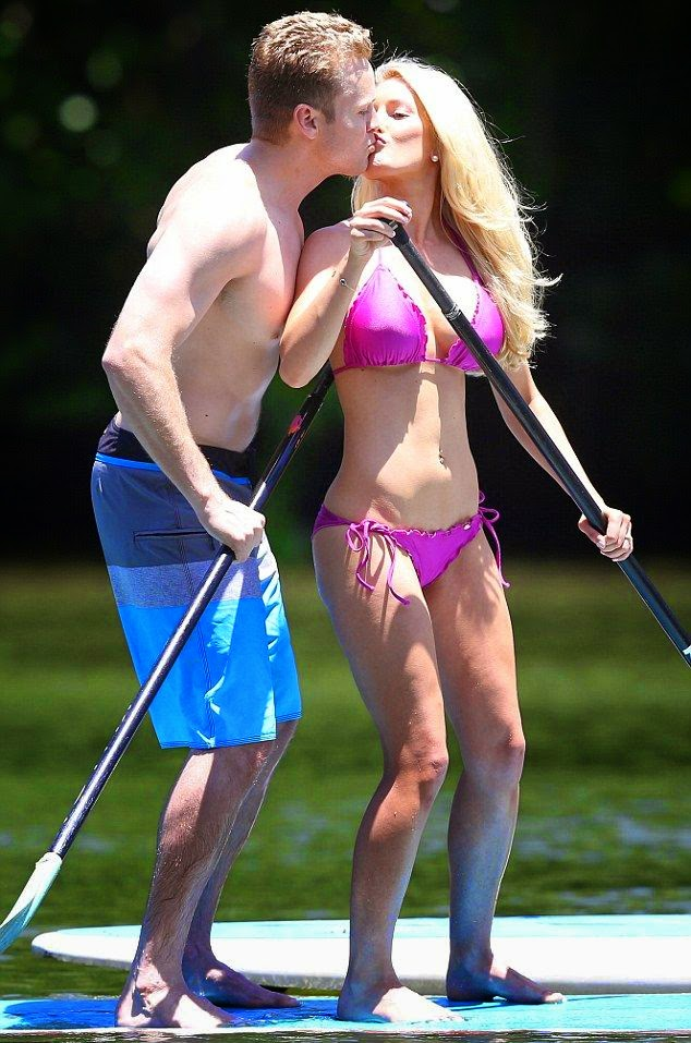 Heidi Montag is in true love and she want to keep it's all to more groovy. The 27-year-old was snapped in a public display of affection with husband, Spencer Pratt during a romantic day in Hawaii on Monday, August 18, 2014.