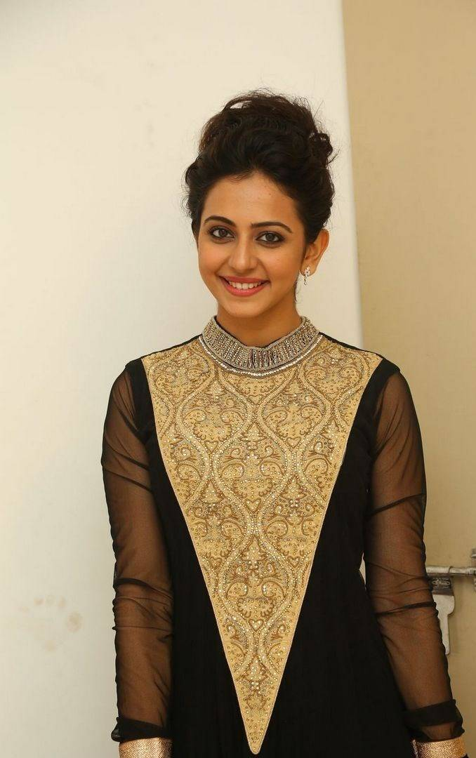 Rakul Preet Singh Pictures in Stylish Long Dress
