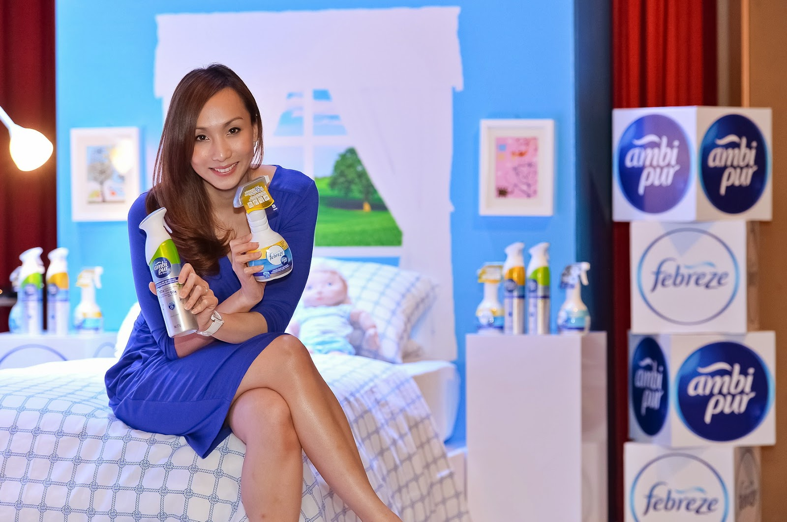 woman posing with dust reducer product on bed