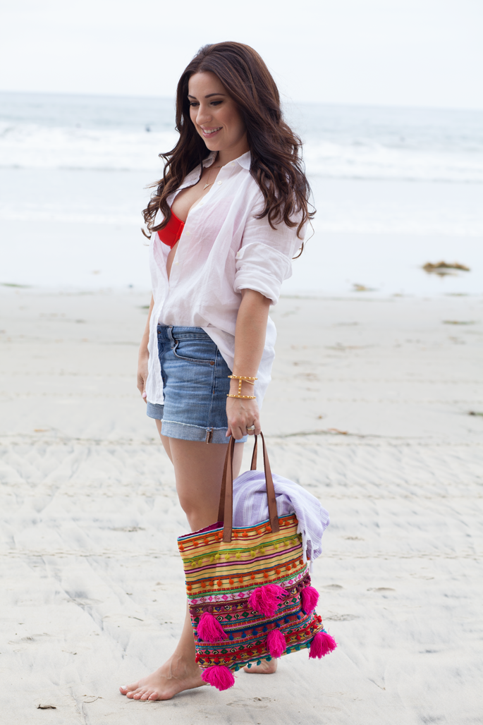 jcrew linen shirt worn as cover up, jcrew bikini and denim shorts, asos pom pom tote