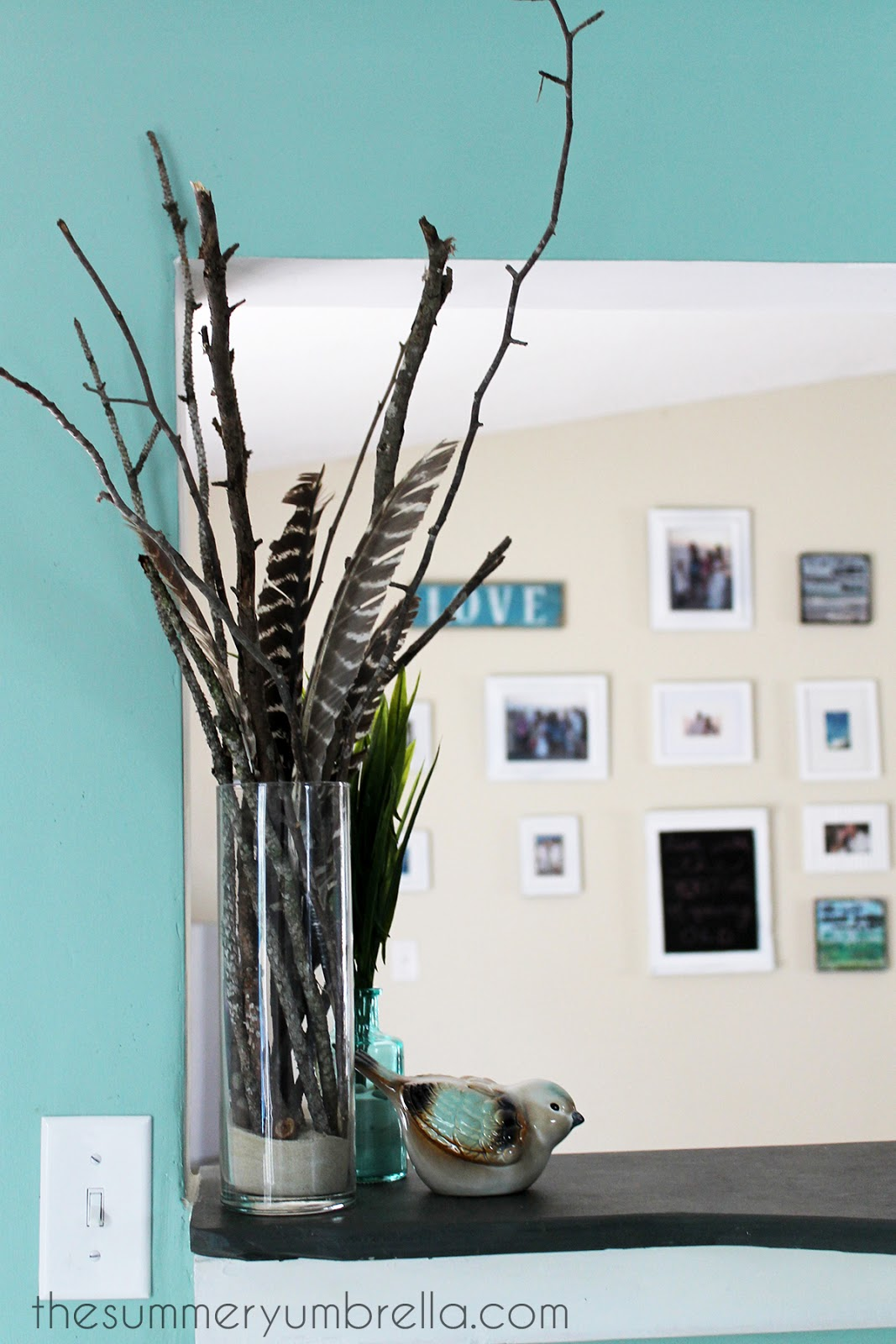 DIY branch and feather centerpiece