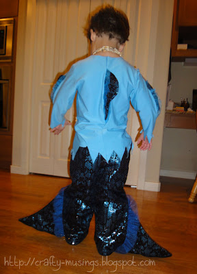 Merboy, back view