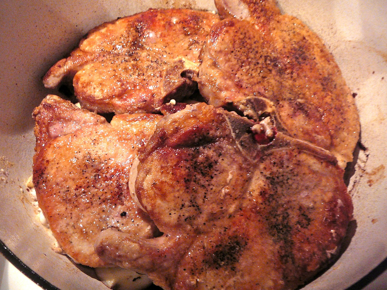Using A Dutch Oven Heat The Oil And Butter Together In The Bottom Over  Medium High Heat Season And Dredge The Chops In Flour And Brown Them For  34 Minutes