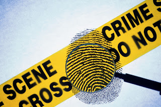 Crime scene tape with a fingerprint superimposed on it.
