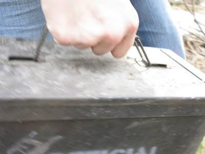 A picture of Jennifer Wirawan's hand carrying a geocache.