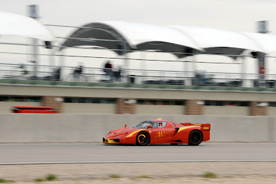 Red Ferrari FXX track racing brakes heated burning fire