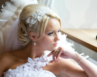 Bride looking out window, blonde wedding hair