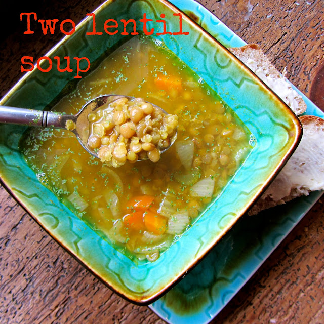 Green ceramic bowl on a matching plate. Lentil soup in the bowl with a metal spoon dipped into it.