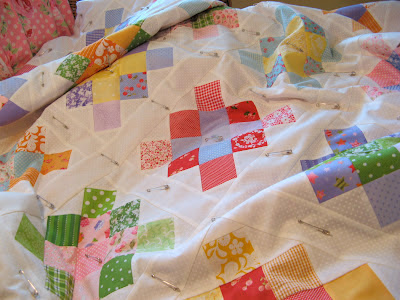Scrappy granny square quilt using fabric by lakehouse dry goods, lecien, susan branch and more