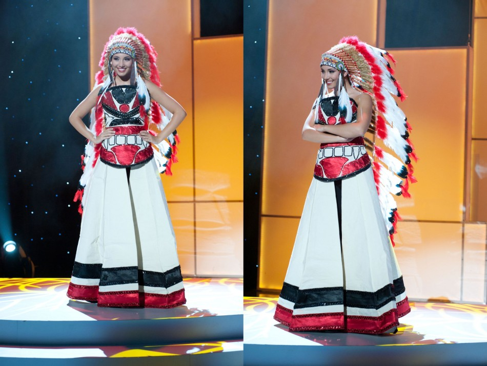 Miss Canada in white, black and red dress with war bonnet.  She stands with her hands crossed in one panel and her hands on her hips in the other.