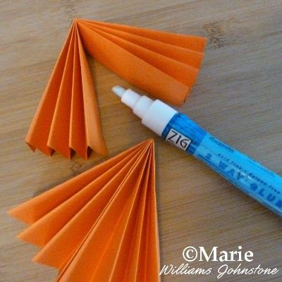 Orange color paper and an adhesive zig glue pen