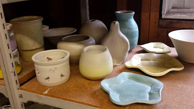 Ceramic pots ready for raku firing, with terra sig already applied.