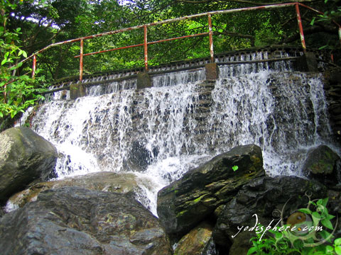 Man-made swimming pool and falls with rushing water