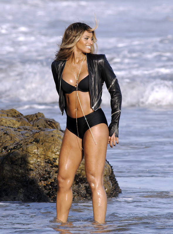 Ciara   wearing a black bikini and leather jacket